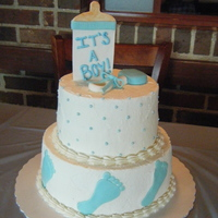 Baby Boy Baby Shower This was for a friends baby shower. Bottom tier is lemon raspberry, top tier is chocolate, iced with buttercream with fondant accents. It...