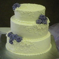 Wedding Cake Cake is buttercream with gum paste roses.