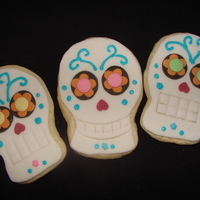 Day Of The Dead Skull Cookies Cream cheese sugar cookies with fondant, buttercream, and sprinkles as decoration.