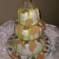 Desiree 3 Tier Pumpkin Wedding Cake. Bride & Groom had me airbrush the cakes in yellow, brown & green with the vines. I had all of the fall...