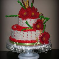 Red Gerber Chocolate with buttercream...silk flowers, gumpaste swirls