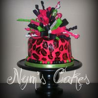Leopard Lingerie chocolate cake with chocolate chip cookie center, cream cheese icing.