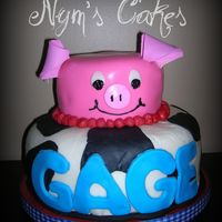 Piggy first birthday cake. vanilla bottom chocoalte top, buttercream with mmf