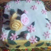 Easter Cake Sponge cake and delicious chocolate cream covered with sugar paste and decorate with roses