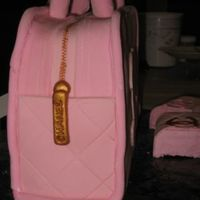 Chanel Purse Cake - Side View Side view showing zipper detail...I used the small Wilton fondant roller to make the zipper pattern.