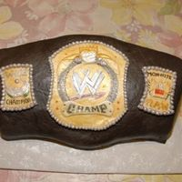 Wwe Championship Belt WWE championship belt cake made for Wrestlemania 23 party! Fondant plaques are hand painted/sculpted. This cake came together at the last...