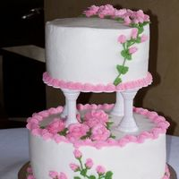 "Small Wedding Cake 7"" red velvet and 10"" white both with butter cream . Made for a small wedding."