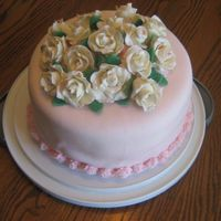 White Chocolate Roses On Pink Fondant The roses are white chocolate modeling clay brushed with luster dust. The fondant is MMF flavored with white chocolate and almond. Cake is...