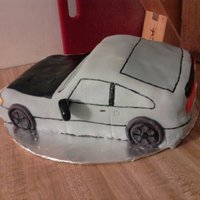 Honda Crx Cake covered in rolled fondant, most of the details are painted on.