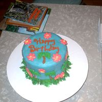 Picture622303.jpg Hawaiian themed birthday party. First time I've used fondant. Royal icing for flowers and palm trees. I used a play-doh molder for the...
