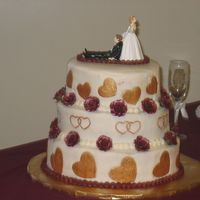 "My First Wedding Cake This is my first wedding cake and I am so glad it is over. I stressed so bad about it. It is a 12, 10 & 8"" chocloate &..."