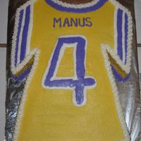 Football Jersey This cake is a yellow cake with bc icing. I didn't have the t-shirt pan, so I just carved it. The birthday boy plays for the youth...