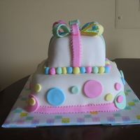 "My First Fondant Cake-Front View This is the front view of an 8"" & 4"" Butter Pecan cake with Buttercream Icing and fondant accents. This was my first all..."