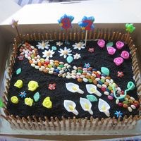 Garden Cake I made this cake for my grandmother's 82nd birthday. She loved it. It is a yellow cake with bc icing and crushed oreos for the dirt....