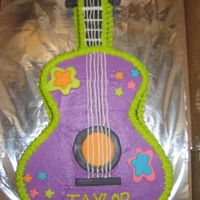 Hannah Montana Guitar This is a yellow cake with bc icing & a few MMF accents. The birthday girl wanted a Hannah Montana cake and this is what I came up with...