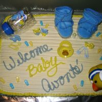 Shay's 1St Shower This is yellow cake with all buttercream except for the gift items. She is a dear friend of mine and her co-workers were giving her a...