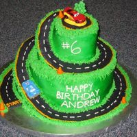 Lightening Mcqueen Birthday Cake Everything was made of buttercream except the construction cones (fondant) and the cars (one was a candle and the other I bought at the...