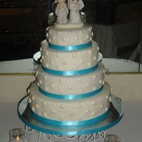 My First Paid Wedding Cake  I made this cake for a girl i went to high school. It was my FIRST paid wedding cake. It was a white cake with strawberry filling. The cake...