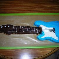 Guitar Cake   This is a cake that was made by an assocoiate I work with. It is a Guitar cake that she made for her sons birthday.