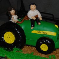 Bride And Groom On John Deere Tractor tractor is cake except for the wheels and they are RCT. The bride and groom are MMF.