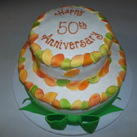 50Th Anniversary Cake two tier with fondant leaves over buttercream