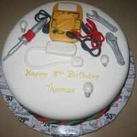 Electrician Cake 18th Birthday cake for an electrician. I was told to do whatever I wanted so I did. A multimetre, soldering iron, light bulbs, powerboard...