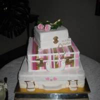 Suitcase Wedding Cake This was for a travel agent. The 2nd tier the stripes were the same pattern that the bridesmaids wore, each stripe was put on individually...
