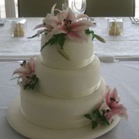 Pink Lily Wedding Cake This was my nephews wedding cake, ivory iced cake and board, pink lilies and roses. Chocolate mud, white mud and butterscotch mud cakes. I...