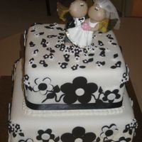 Black & White Wedding Cake The bride said she wanted a black & white wedding cake for 50 people, with the bride and groom topper she supplied. She didn't...