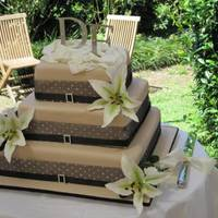 Outside Wedding I really liked this cake simply but effective. All white chocolate mud cake. Gumpaste lilies with small white roses. Monogram topper set in...