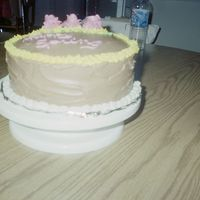 Practice Ckae Two layer yellow with chocolate icing between layers and on top and all around the cake.