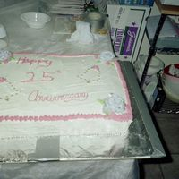 Silver Anniversary This cake believe it or not was a two layer sheet cake. Half chocolate and half vanilla. It was not an easy cake. Needed an extra hand with...