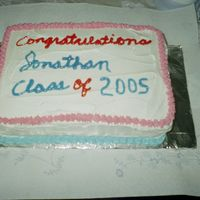 High School Graduation Half sheet chocolate cake with buttercream icing. Color of decors reflects school colors.