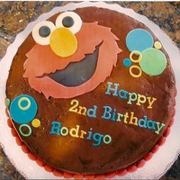 Elmo Chocolate buttercream looks sloppy but I'm very happy with Elmo's face. I love the lettering! Client gave me the plate she was...