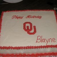 Ou Birthday Cake Strawberry cake with buttercream icing decorated with Oklahoma University Logo.