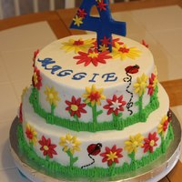 Flower Garden 4Th Birthday 2-Tier Cake   Made this for a friends little girls garden birthday party cake...make to match dress and invites. Buttercream with fondant decorations.