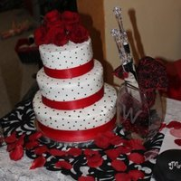 3 Tier Red/black Dots Wedding Cake 3 Tier wedding cake done in buttercream with small black dots and red ribbon accent. Clients chose to deliver and assemble themselves at...