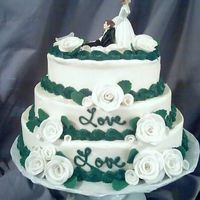 The Love,love Cake  This was for a end of Oct. wedding. The Bride really wanted hunter green roses until I gave her the idea of just the border in hunter green...