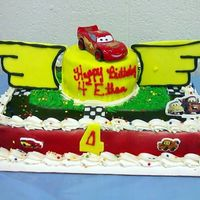 Lightning Mcqueen  I wanted to make the top cake look like the top of the piston cup but the wings were just way too big!! It didn't turn out like I saw...