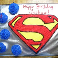 Superman Birthday I used a sheet cake to freehand the shape of this cake. I could not find a Superman emblem pan. I drew out the design on wax paper,...