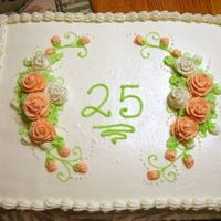 25Th Anniversary   This was a vanilla cake with chocolate mousse filling and decorated with buttercream frosting.