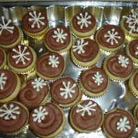 Snowflake Cupcakes   Mini snow flake cupcakes with royal icing snowflakes.
