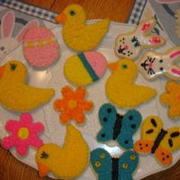 Easter Cookies   These are easter cut out with buttercream icing and some with sugar cookie icing.