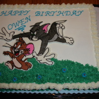 Tom And Jerry  This was a birthday cake for my 6 year old that he wanted. It was a white cake with buttercream frosting. The Tom and Jerry picture is a...