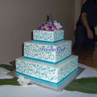 "Teal Floral Scroll Wedding Cake  3 tier stacked cake, 6-10-14"", red velvet/cream cheese and double chocolate/chocolate BC. BC iced and decorated with scrolls, flowers..."