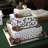 Chocolate Covered Strawberry Wedding Cake  Three tiers, 6-10-14, icing in vanilla bean buttercream, piping done in ganache with #13 star tip and various round tips. Bottom borders #...