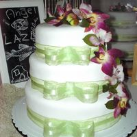 Wedding Cake THis is a lemon flavor cake with lemon curd and raspberries, covered wiht mmf. Made for the wedding of a friend.