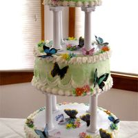 Butterfly Garden Gumpaste flowers and waferpaper butterflies.