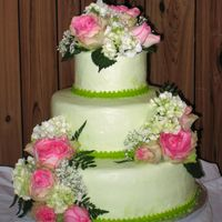 Simply Green Frosted with green buttercream icing, this cake was decorated with fresh flowers.