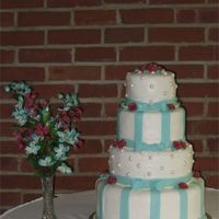 Aqua Pearl Cake is frosted with Buttercream. Stripes and pearls are made of fondant.